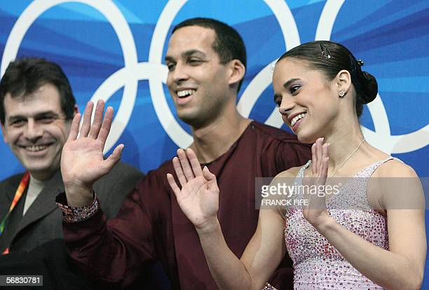 US pair Marcy Hinzmann and Aaron Parchem wave to the crowd as they wait for the results of their performance in the Pairs Short Program during the...