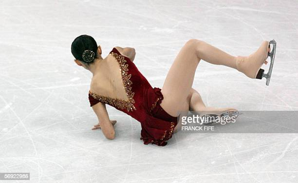 US Sasha Cohen misses a figure and falls down in the ladies free skating program during the Figure skating competition at the 2006 Winter Olympics 23...