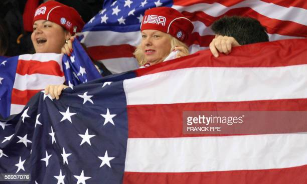 US supporters watch the mens' 5000m relay final during the short track competition at the 2006 Winter Olympics 25 February 2006 at the Palavela in...