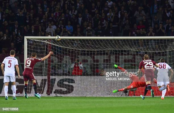 Turin's forward Andrea Belotti fails to score a penalty kick during the Italian Serie A football match Turin vs AC Milan at the Olimpico stadium in...