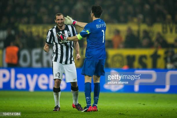 Turin's goalkeeper Gianluigi Buffon and Giorgio Chiellini celebrate during the Champions League Round of Sixteen soccer match Borussia Dortmund vs...