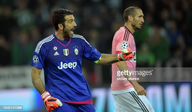 Turin's goalkeeper Gianluigi Buffon and Girogio Chillini react during the Champions League group D soccer match Borussia Moenchengladbach vs Juventus...