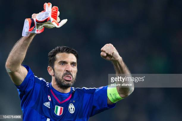 Turin's goalkeeper Gianluigi Buffon celebrates during the Champions League group D soccer match Borussia Moenchengladbach vs Juventus Turin in...