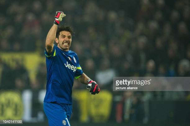 Turin's goalkeeper Gianluigi Buffon cheers during the Champions League Round of Sixteen soccer match Borussia Dortmund vs Juventus Turin in Dortmund...