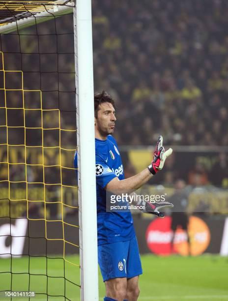 Turin's goalkeeper Gianluigi Buffon reacts during the Champions League Round of Sixteen soccer match Borussia Dortmund vs Juventus Turin in Dortmund...