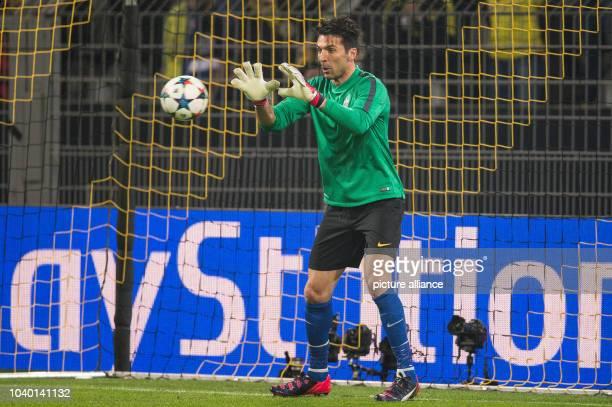 Turin's goalkeeper Gianluigi Buffon warming up before the Champions League Round of Sixteen soccer match Borussia Dortmund vs Juventus Turin in...