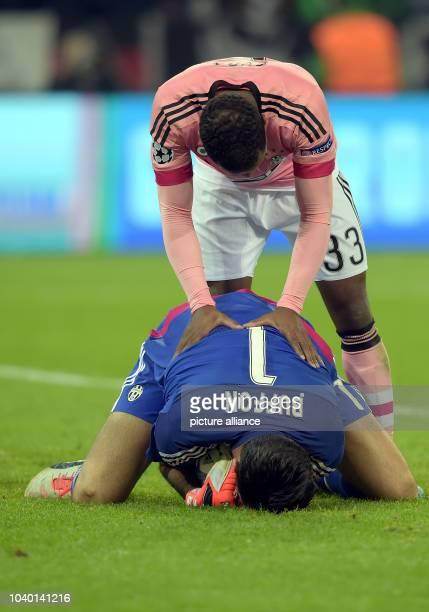 Turin's Patrice Evra and goalkeeper Gianluigi Buffon react during the Champions League group D soccer match Borussia Moenchengladbach vs Juventus...
