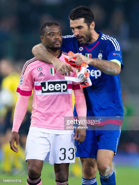Turin's Patrice Evra and goalkeeper Gianluigi Buffon reacts during the Champions League group D soccer match Borussia Moenchengladbach vs Juventus...