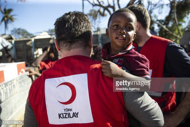 Turish Red Crescent member is seen as Mozambiqueans receive humanitarian aid sent by Turkish aid agencies in Muabvi village of Beira Mozambique...