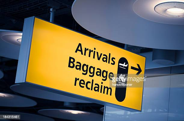 turist information and  baggage arrivals signs on Heathrow airport
