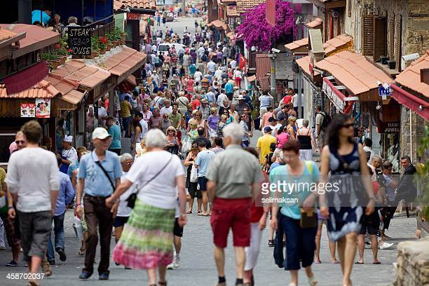 Turists walking on main setreet in town of Side Antalya