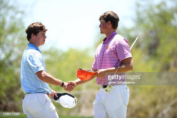 Turk Pettit of the Clemson Tigers and Peter Fountain of the North Carolina Tar Heels shake hands during the Division I Mens Golf Championship held at...