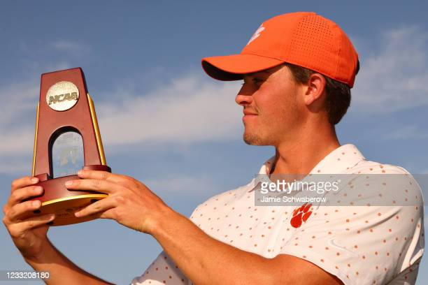 Turk Pettit of the Clemson Tigers celebrates after winning the individual title during the Division I Mens Golf Championship held at the Grayhawk...
