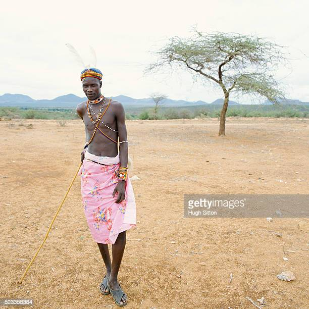 turkana tribesman in the desert landscape - hugh sitton stock pictures, royalty-free photos & images
