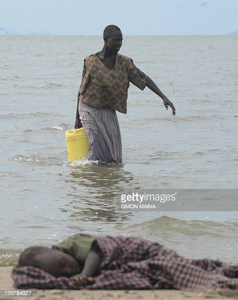 A Turkana woman fetches water from Lake Turkana on August 102011 Oxfam food aid project funded by the EU gives food vouchers to vulnerable families...