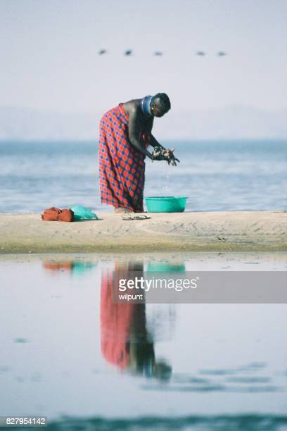 Turkana Woman Washing Reflection