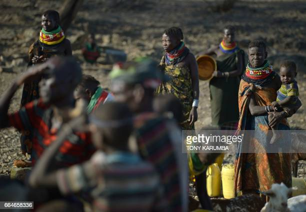 Turkana women gather near a rapidly drying waterhole near Lokitaung in Northern Kenya's Turkana county where a biting drought has ravaged livestock...