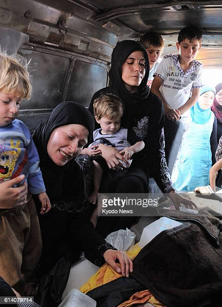 KILIS Turkey A family of Syrian refugees in Kilis a border area in southern Turkey grieve on Sept 16 over the death of a rebel soldier after his body...