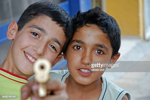 Turkey Anatolia Urfa boys with a water pistol