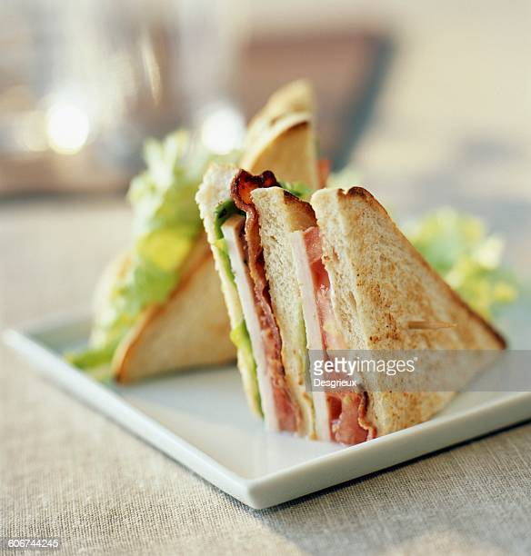 turkey and bacon club sandwich - club sandwich stock pictures, royalty-free photos & images