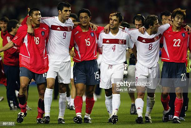 Turkey and South Korea players embrace each other after the FIFA World Cup Finals 2002 Third Place PlayOff match played at the Daegu World Cup...