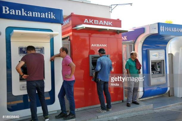 Ankara Men withdrawing cash from an ATM at the Gimsa Batikent hypermarket Bankamatik AKbank Halkbank
