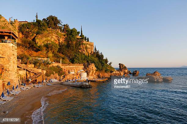 turkey, antalya, beach at harbor - antalya province stock pictures, royalty-free photos & images