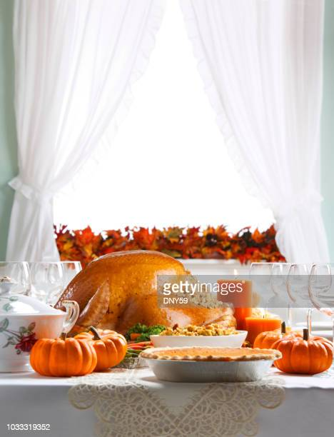 turkey as centerpiece for a thanksgiving feast - thanksgiving decoration stock pictures, royalty-free photos & images