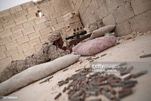 A Turkey backed Syrian rebelfighter aims his rifle near the city of alBab in the Aleppo province on the border with Turkey on October 8 2018 Jihadist...