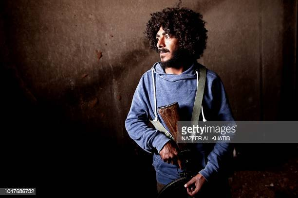 A Turkey backed Syrian rebelfighter looks on near the city of alBab in the Aleppo province on the border with Turkey on October 8 2018 Jihadist...