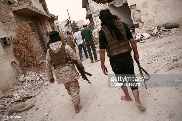 Turkey backed Syrian rebelfighters patrol near the city of alBab in the Aleppo province on the border with Turkey on October 8 2018 Jihadist factions...