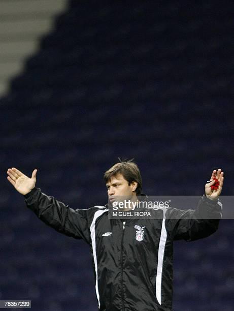 Turkey Besiktas's coach Ertugrul Saglam reacts during their team training session at the Dragao stadium in Porto 10 December 2007 ahead of their...