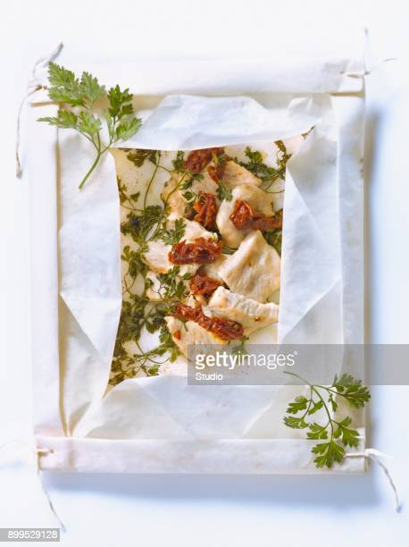 Turkey breasts,sun-dried tomatoes and herbs cooked in wax paper