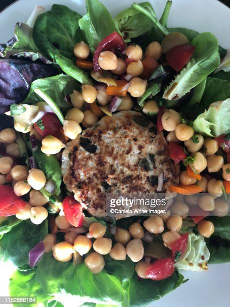 turkey burger and salad - turkey burger stock pictures, royalty-free photos & images