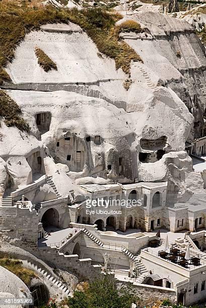Turkey Cappadocia Goreme Cave hotel built into white tufa rock of hillside
