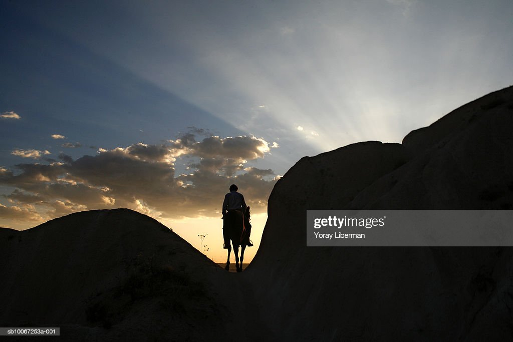 Turkey, Cappadocia, Rose Valley, silhouette of man on horseback : News Photo
