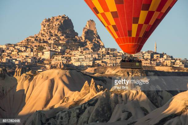 Turkey, Central Anatolia, Cappadocia, Hot air balloon flying over Uchisar Castle near Goreme