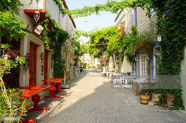 turkey, cesme, alacati, traditional alley in village - izmir stock pictures, royalty-free photos & images
