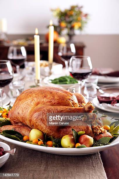 Turkey dish on table set with wine and candles