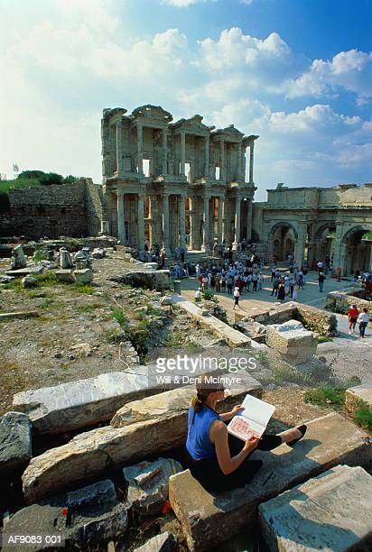 turkey, ephesus, tourist drawing the library of celsus - drew mcintyre stock pictures, royalty-free photos & images