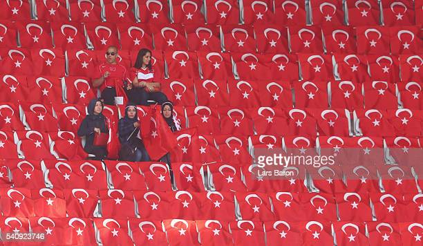 Turkey fans sit with Turkish national flags prior to the UEFA EURO 2016 Group D match between Spain and Turkey at Allianz Riviera Stadium on June 17...
