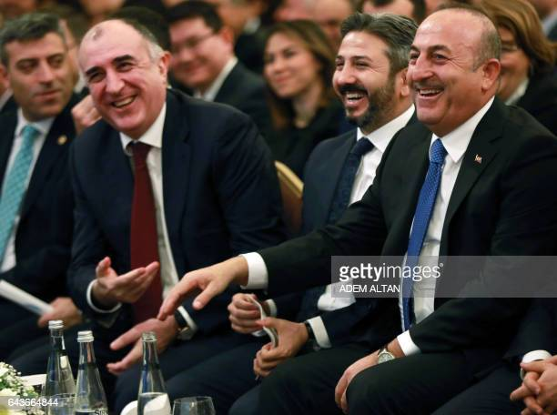 Turkey Foreign Minister Mevlut Cavusoglu and his Azerbaijan's counterpart Elmar Mammadyarov speak during a conference to commemorate the 25th...