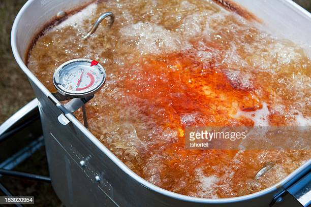 turkey frying in an outdoor deep fryer - fried stock pictures, royalty-free photos & images