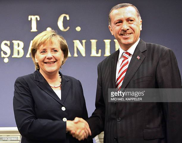German Chancellor Angela Merkel and Turkish Prime Minister Recep Tayyip Erdogan shake hands before holding a joint press conference 05 October 2006...