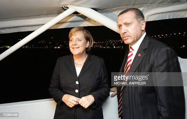 German Chancellor Angela Merkel and Turkish Prime Minister Recep Tayyip Erdogan take a ride on a boat on the river Bosporus 05 October 2006 in...