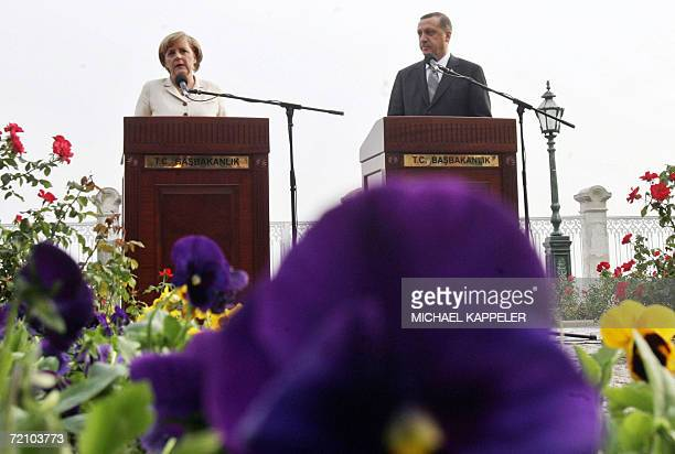 German Chancellor Angela Merkel and Turkish Prime Minister Recep Tayyip Erdogan face journalists after talks with Turkey's religious leaders 06...