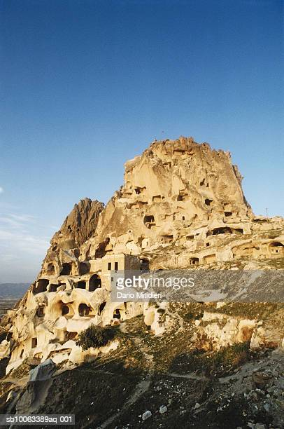 turkey, goreme, dwellings caved rock formation in goreme valley - central anatolia stock photos and pictures