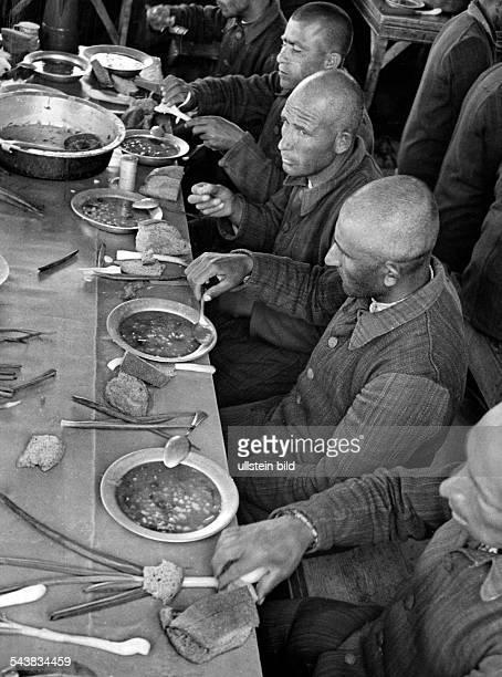 Turkey : Imrali, Turkish island in the Sea of Marmara, used as a prison, prisoners having lunch - Photographer: Bernd Lohse- undatedVintage property...