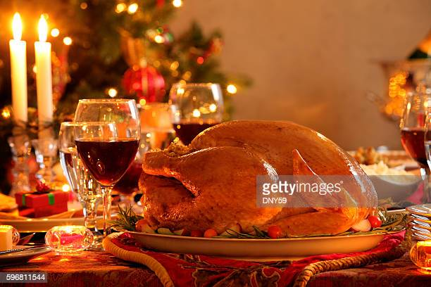 turkey in a christmas dinner setting - thanksgiving turkey stock photos and pictures