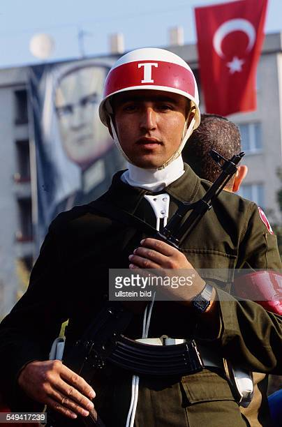 mitliary parade for the 81th anniversary of the Turkey A soldier in front of the portrait of Mustafa Kemal Atatuerk and the Turkish flag
